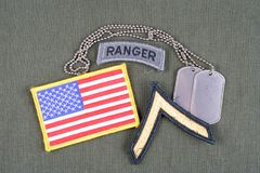 US ARMY Private rank patch, ranger tab, flag patch and dog tag on olive green uniform Royalty Free Stock Images