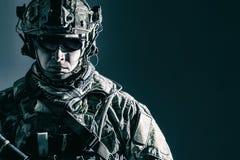 US Army Ranger close-up. Elite member of US Army rangers in combat helmet and dark glasses. Studio shot, dark black background, looking at camera, dark contrast royalty free stock images