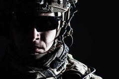 US Army Ranger close-up. Elite member of US Army rangers in combat helmet and dark glasses. Studio shot, dark black background, looking at camera, dark contrast royalty free stock photography