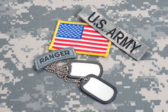 US ARMY ranger tab with blank dog tags on camouflage uniform. Concept Stock Photography