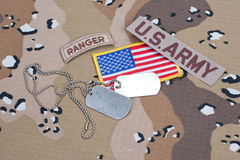 US ARMY ranger tab with blank dog tags on camouflage uniform. Concept Royalty Free Stock Image
