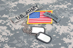 US ARMY ranger tab with blank dog tags on camouflage uniform Royalty Free Stock Image