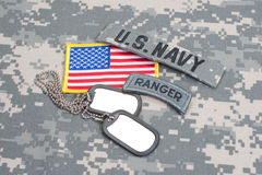 US ARMY ranger tab with blank dog tags on camouflage uniform Stock Photos