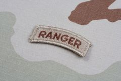 US ARMY ranger tab on camouflage uniform Stock Image