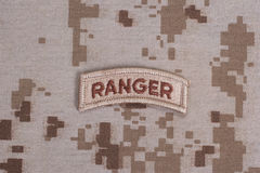 US ARMY ranger tab on camouflage uniform Stock Photos