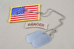 US ARMY ranger tab with dog tag. Background Stock Photos