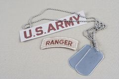 US ARMY ranger tab with dog tag. Background Royalty Free Stock Images