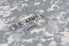 US ARMY ranger tab with dog tag on camouflage uniform Royalty Free Stock Images