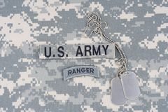 US ARMY ranger tab with dog tag on camouflage uniform Royalty Free Stock Image