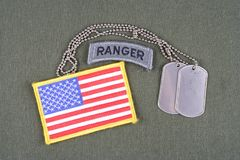 US ARMY ranger tab with dog tag and flag patch on olive green uniform Stock Photography