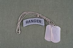 US ARMY ranger tab with dog tag on olive green uniform Royalty Free Stock Photos