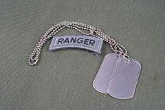 US ARMY ranger tab with dog tag on olive green uniform Stock Photography