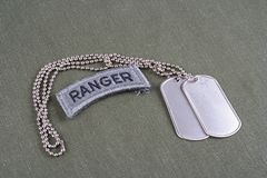 US ARMY ranger tab with dog tag. On olive green uniform Stock Photography