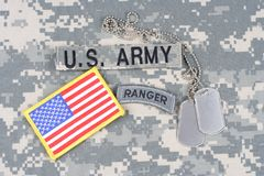 US ARMY ranger tab, flag patch,  with dog tag on camouflage uniform Royalty Free Stock Photos