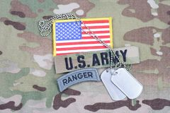 US ARMY ranger tab, flag patch,  with dog tag on camouflage uniform Royalty Free Stock Image
