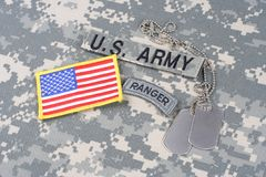US ARMY ranger tab, flag patch,  with dog tag on camouflage uniform Royalty Free Stock Photo