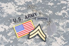 US ARMY ranger tab, flag patch,  with dog tag on camouflage uniform Stock Image