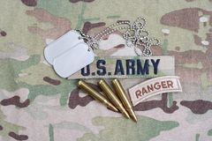 US ARMY ranger tab, flag patch,  with dog tag and 5.56 mm rounds on camouflage uniform Royalty Free Stock Photos