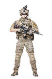 US Army Ranger with weapon. Elite member of US Army rangers in combat uniforms with his shirt sleeves rolled up, in helmet, eyewear and night vision goggles royalty free stock images