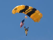 US Army's Golden Knight With Old Glory Stock Photo