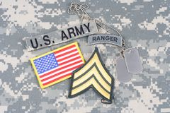 US ARMY Sergeant rank patch, ranger tab, flag patch,  with dog tag on camouflage uniform Stock Photography