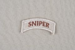US ARMY sniper tab. Background Royalty Free Stock Images