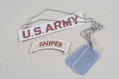 US ARMY sniper tab with dog tag. Background Stock Image