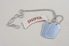 US ARMY sniper tab with dog tag. And flag patch Royalty Free Stock Photography