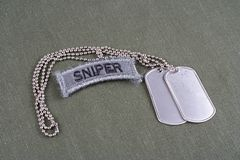 US ARMY sniper tab with dog tag. And flag patch on olive green uniform Royalty Free Stock Photography