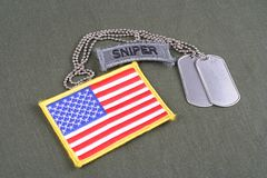 US ARMY sniper tab with dog tag. And flag patch on olive green uniform Royalty Free Stock Image
