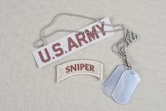 US ARMY sniper tab with dog tag. A senior Russian military official has said t Stock Images