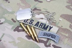 US ARMY sniper tab, flag patch, with dog tag and 5.56 mm rounds and 5.56 mm rounds on uniform. US ARMY sniper tab, flag patch, with dog tag and 5.56 mm rounds Royalty Free Stock Photography