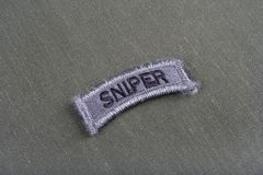 US ARMY sniper tab on olive green uniform. Background Royalty Free Stock Photo