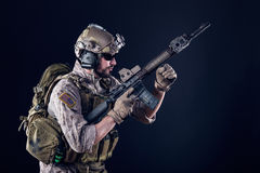 US Army Soldier on Dark Background. Portrait of Bearded US Army Soldier on Dark Background royalty free stock photos