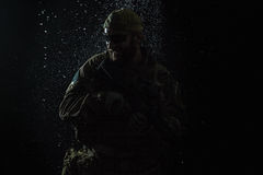 US Army soldier in the rain Stock Photo