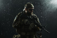 US Army soldier in the rain Royalty Free Stock Image