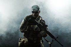 US Army soldier in the rain. Green Berets US Army Special Forces Group soldier in the rain stock images