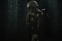 US Army soldier in the rain Royalty Free Stock Photo