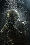 US Army soldier in the rain. Green Berets US Army Special Forces Group soldier in the rain Royalty Free Stock Photography