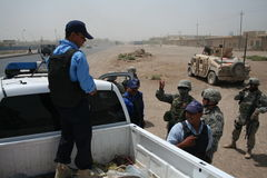 US Army Soldiers check Iaqi Police at Checkpoint Stock Photos