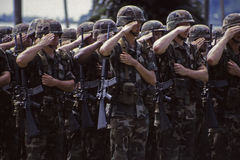 US Army soldiers saluting. PANAMA Panama City -- 01 Oct 1996 -- US Army soldiers salute while on parade during the handover ceremony of Fort Amador in Panama Stock Photography