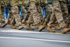 US Army soldiers take part at the Romanian National Day military parade