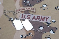 US ARMY special forces tab with blank dog tags on camouflage uniform. Concept Royalty Free Stock Images