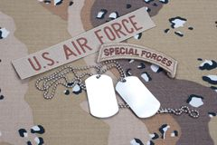 US ARMY special forces tab with blank dog tags on camouflage uniform Royalty Free Stock Photo