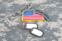US ARMY special forces tab with blank dog tags on camouflage uniform Royalty Free Stock Photos