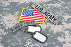 US ARMY special forces tab with blank dog tags on camouflage uniform Stock Photography