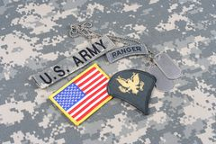 US ARMY Specialist rank patch, ranger tab, flag patch,  with dog tag on camouflage uniform Stock Photo
