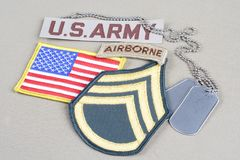 US ARMY Staff Sergeant rank patch, airborne tab, flag patch and dog tag. Background stock photography