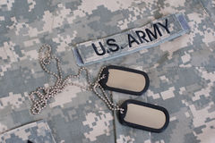 Us army camouflaged uniform with blank dog tags Stock Images