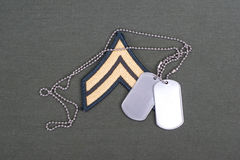 Us army uniform with blank dog tags and sergeant rank patch Stock Photo